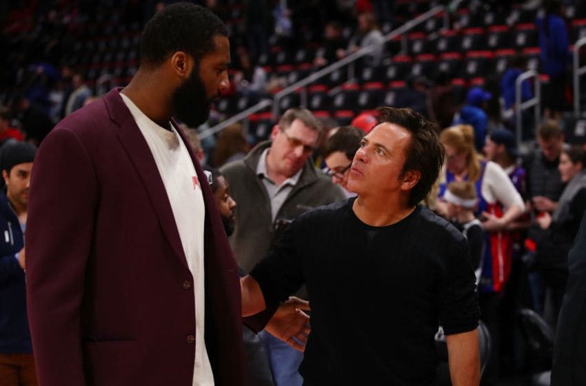 Detroit Pistons owner Tom Gores talks with Andre Drummond. (Photo by Gregory Shamus/Getty Images)