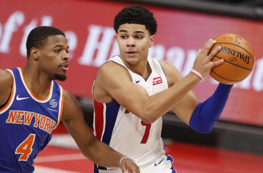 Dec 13, 2020; Detroit, Michigan, USA; Detroit Pistons guard Killian Hayes (7) drives to the basket against New York Knicks guard Dennis Smith Jr. (4). Mandatory Credit: Raj Mehta-USA TODAY Sports