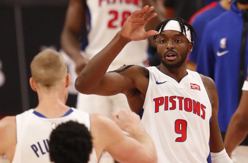 Detroit Pistons forward Jerami Grant (9) celebrates with center Mason Plumlee (24) Mandatory Credit: Raj Mehta-USA TODAY Sports