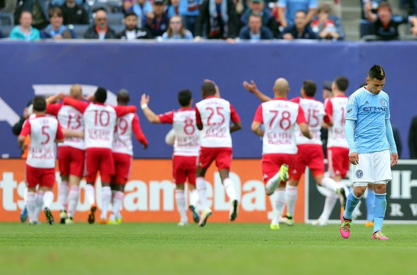 May 21, 2016; New York, NY, USA; New York City FC midfielder Mikey Lopez (5) reacts as New York Red Bulls forward Bradley Wright-Phillips (99) celebrates his goal with teammates during the first half at Yankee Stadium. Mandatory Credit: Brad Penner-USA TODAY Sports