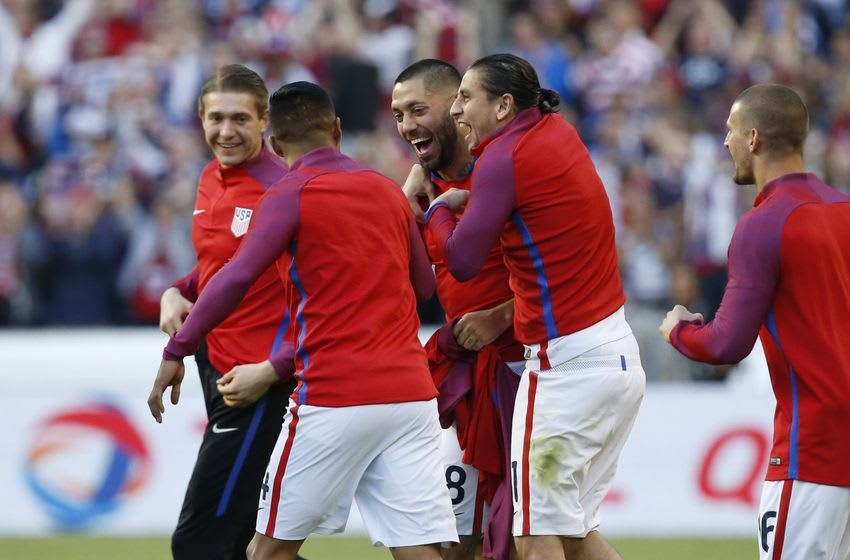 Jun 16, 2016; Seattle, WA, USA; United States forward Clint Dempsey (middle) is hugged by midfielder Alejandro Bedoya (right) following a 2-1 victory against Ecuador during quarter-final play in the 2016 Copa America Centenario soccer tournament at Century Link Field. Mandatory Credit: Joe Nicholson-USA TODAY Sports