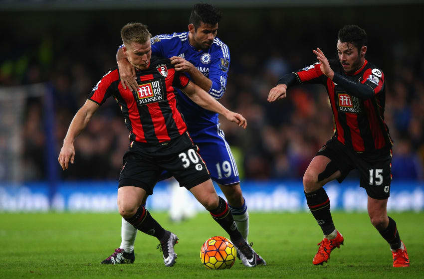 LONDON, ENGLAND - DECEMBER 05: Diego Costa (C) of Chelsea fouls Matt Ritchie (L) of Bournemouth resulting in an yellow card during the Barclays Premier League match between Chelsea and A.F.C. Bournemouth at Stamford Bridge on December 5, 2015 in London, England. (Photo by Ian Walton/Getty Images)