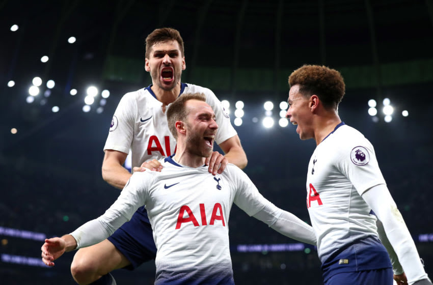 LONDON, ENGLAND - APRIL 23: Christian Eriksen of Tottenham Hotspur celebrates with teammates after scoring his team's first goal during the Premier League match between Tottenham Hotspur and Brighton & Hove Albion at Tottenham Hotspur Stadium on April 23, 2019 in London, United Kingdom. (Photo by Clive Rose/Getty Images)