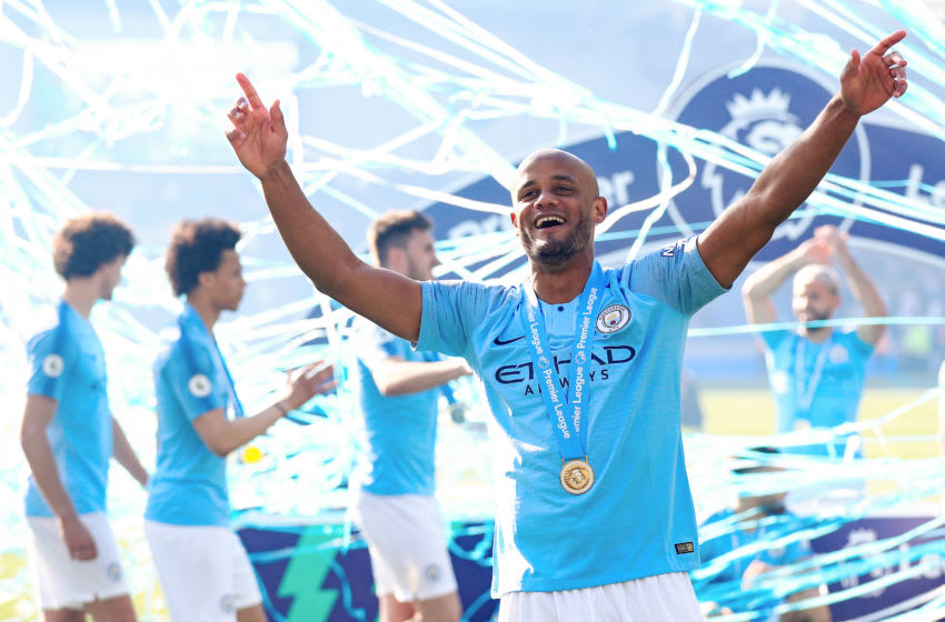 BRIGHTON, ENGLAND - MAY 12: Vincent Kompany of Manchester City celebrates after winning the Premier League title following the Premier League match between Brighton & Hove Albion and Manchester City at American Express Community Stadium on May 12, 2019 in Brighton, United Kingdom. (Photo by Matt McNulty - Manchester City/Man City via Getty Images)