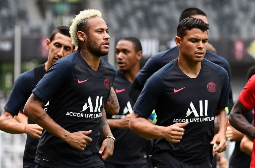 Neyar and Thiago Silva, Paris Saint-Germain (Photo credit should read FRANCK FIFE/AFP/Getty Images)