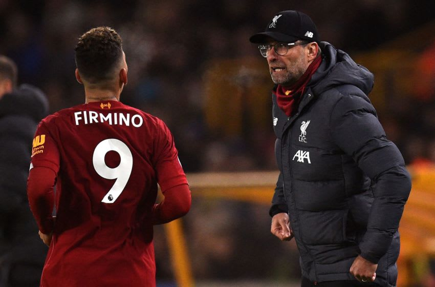 Liverpool's Brazilian midfielder Roberto Firmino (L) and Liverpool's German manager Jurgen Klopp react at the final whistle during the English Premier League football match between Wolverhampton Wanderers and Liverpool at the Molineux stadium in Wolverhampton, central England on January 23, 2020. (Photo by Oli SCARFF / AFP) / RESTRICTED TO EDITORIAL USE. No use with unauthorized audio, video, data, fixture lists, club/league logos or 'live' services. Online in-match use limited to 120 images. An additional 40 images may be used in extra time. No video emulation. Social media in-match use limited to 120 images. An additional 40 images may be used in extra time. No use in betting publications, games or single club/league/player publications. / (Photo by OLI SCARFF/AFP via Getty Images)