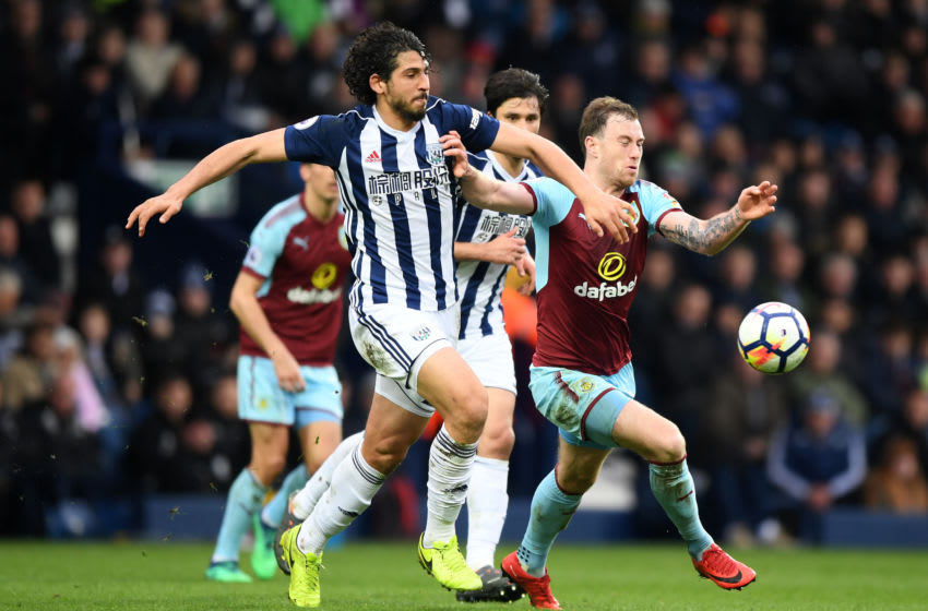 WEST BROMWICH, ENGLAND - MARCH 31: Ashley Barnes of Burnley is challenged by Ahmed El-Sayed Hegazi of West Bromwich Albion during the Premier League match between West Bromwich Albion and Burnley at The Hawthorns on March 31, 2018 in West Bromwich, England. (Photo by Shaun Botterill/Getty Images)