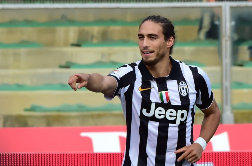 Juventus' Uruguayan defender Jose Martin Caceres celebrates after scoring a goal during the Serie A football match Chievo Verona vs Juventus at the Bentegodi Stadium in Verona on August 30, 2014. AFP PHOTO / GIUSEPPE CACACE (Photo credit should read GIUSEPPE CACACE/AFP/Getty Images)