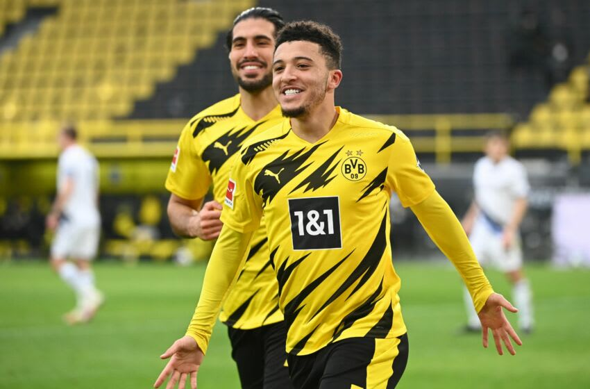 Dortmund's English midfielder Jadon Sancho celebrates scoring a penalty during the German first division Bundesliga football match between Borussia Dortmund and DSC Arminia Bielefeld in Dortmund, western Germany, on February 27, 2021. (Photo by Ina Fassbender / various sources / AFP) / DFL REGULATIONS PROHIBIT ANY USE OF PHOTOGRAPHS AS IMAGE SEQUENCES AND/OR QUASI-VIDEO (Photo by INA FASSBENDER/AFP via Getty Images)