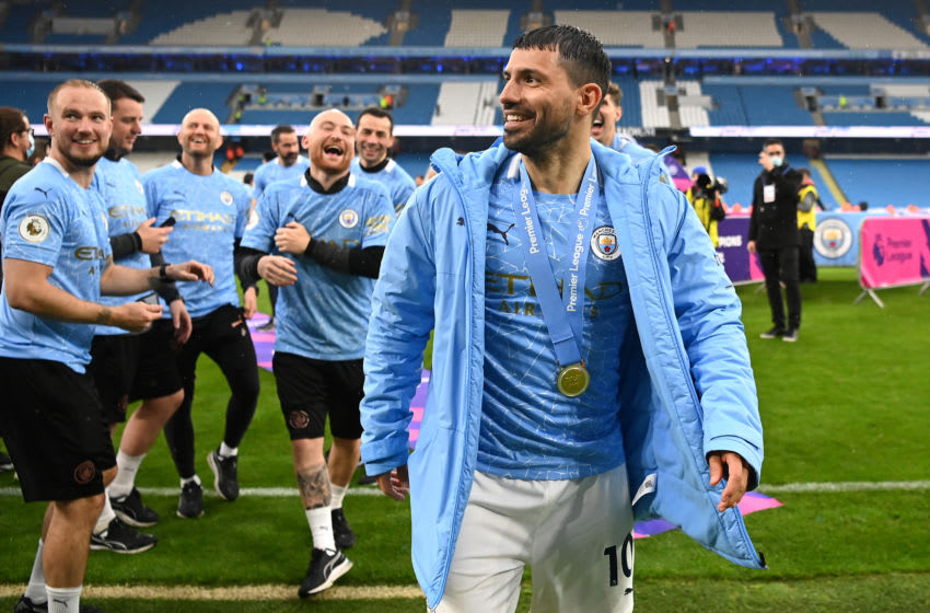 MANCHESTER, ENGLAND - MAY 23: Sergio Aguero of Manchester City looks on after Manchester City are presented with the Trophy as they win the league following the Premier League match between Manchester City and Everton at Etihad Stadium on May 23, 2021 in Manchester, England. A limited number of fans will be allowed into Premier League stadiums as Coronavirus restrictions begin to ease in the UK. (Photo by Michael Regan/Getty Images)