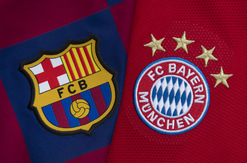 MANCHESTER, ENGLAND - SEPTEMBER 12: The FC Barcelona and FC Bayern Munich club badges on their first team home shirts ahead of their UEFA Champions League Group E match at the Camp Nou, Barcelona on September 12, 2021 in Manchester, United Kingdom. (Photo by Visionhaus/Getty Images)