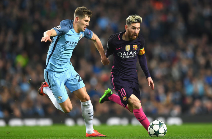 Lionel Messi and John Stones, Manchester City vs Barcelona (Photo by Shaun Botterill/Getty Images)