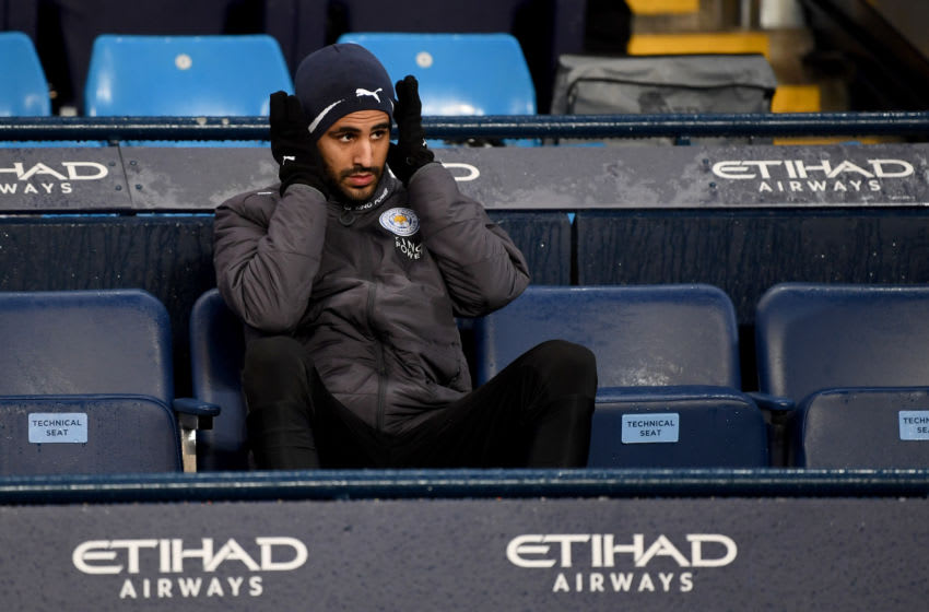 MANCHESTER, ENGLAND - FEBRUARY 10: Riyad Mahrez of Leicester City looks on from the bench prior to the Premier League match between Manchester City and Leicester City at Etihad Stadium on February 10, 2018 in Manchester, England. (Photo by Michael Regan/Getty Images)
