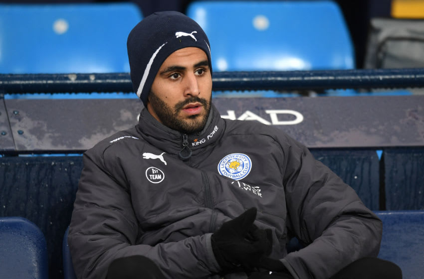 MANCHESTER, ENGLAND - FEBRUARY 10: Riyad Mahrez of Leicester City looks on from the bench during the Premier League match between Manchester City and Leicester City at Etihad Stadium on February 10, 2018 in Manchester, England. (Photo by Michael Regan/Getty Images)