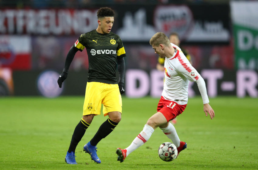 LEIPZIG, GERMANY - JANUARY 19: Jadon Sancho of Borussia Dortmund nutmegs Timo Werner of RB Leipzig during the Bundesliga match between RB Leipzig and Borussia Dortmund at Red Bull Arena on January 19, 2019 in Leipzig, Germany. (Photo by Adam Pretty/Bongarts/Getty Images)