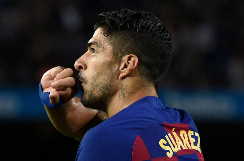 Barcelona's Uruguayan forward Luis Suarez celebrates his goal during the Spanish league football match between FC Barcelona and Sevilla FC at the Camp Nou stadium in Barcelona on October 6, 2019. (Photo by Josep LAGO / AFP) (Photo by JOSEP LAGO/AFP via Getty Images)