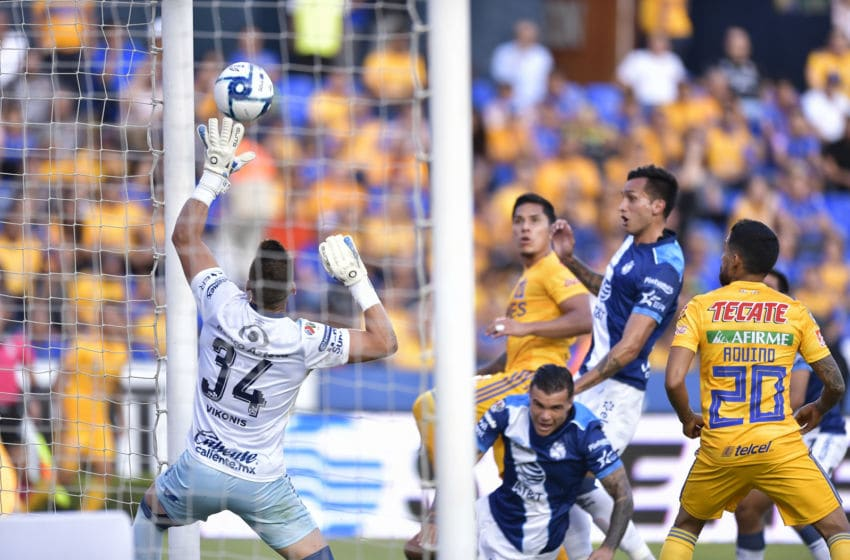Puebla goalie Nicolás Vikonis (34) bats the ball off his line during his team's 0-0 draw against the Tigres on Matchday 9. Vikonis leads the league in save percentage and is tied for best with 5 shut-outs. (Photo by Azael Rodriguez/Getty Images)