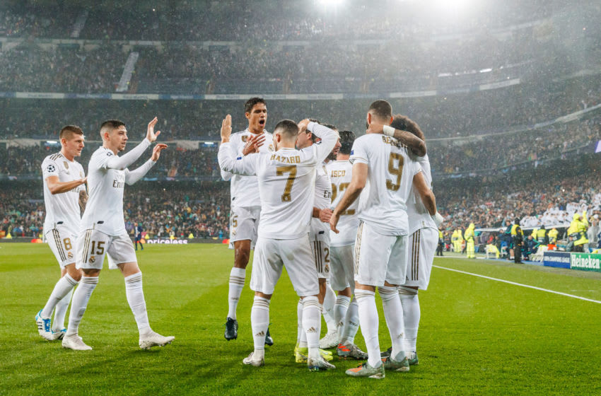 MADRID, SPAIN - NOVEMBER 26: Karim Benzema of Real Madrid celebrates his goal with team mates during the UEFA Champions League group A match between Real Madrid and Paris Saint-Germain at Bernabeu on November 26, 2019 in Madrid, Spain. (Photo by TF-Images/Getty Images)