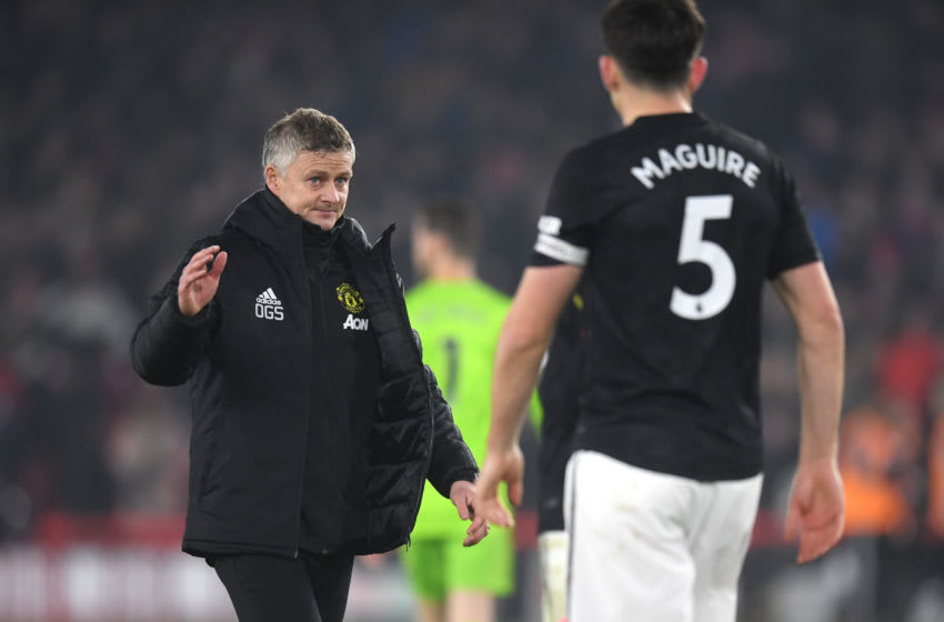 SHEFFIELD, ENGLAND - NOVEMBER 24: Ole Gunnar Solskjaer, Manager of Manchester United interacts with Harry Maguire of Manchester United following the Premier League match between Sheffield United and Manchester United at Bramall Lane on November 24, 2019 in Sheffield, United Kingdom. (Photo by Michael Regan/Getty Images)
