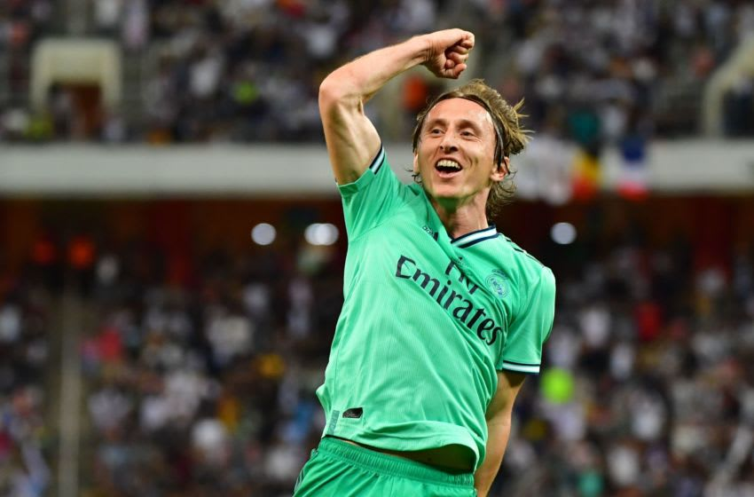 TOPSHOT - Real Madrid's Croatian midfielder Luka Modric celebrates his goal during the Spanish Super Cup semi final between Valencia and Real Madrid on January 8, 2020, at the King Abdullah Sport City in the Saudi Arabian port city of Jeddah. (Photo by GIUSEPPE CACACE / AFP) (Photo by GIUSEPPE CACACE/AFP via Getty Images)