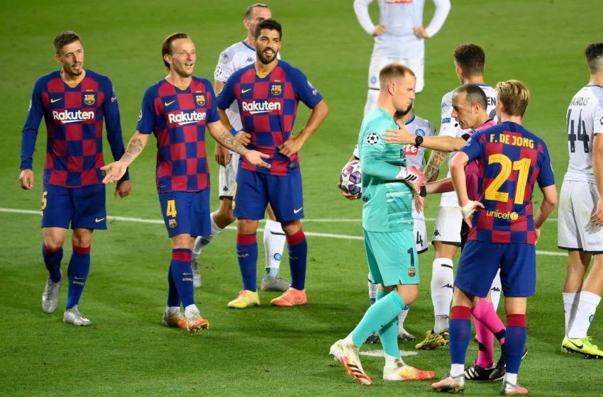 Barcelona players during the match against Napoli. (Photo by LLUIS GENE / AFP) (Photo by LLUIS GENE/AFP via Getty Images)
