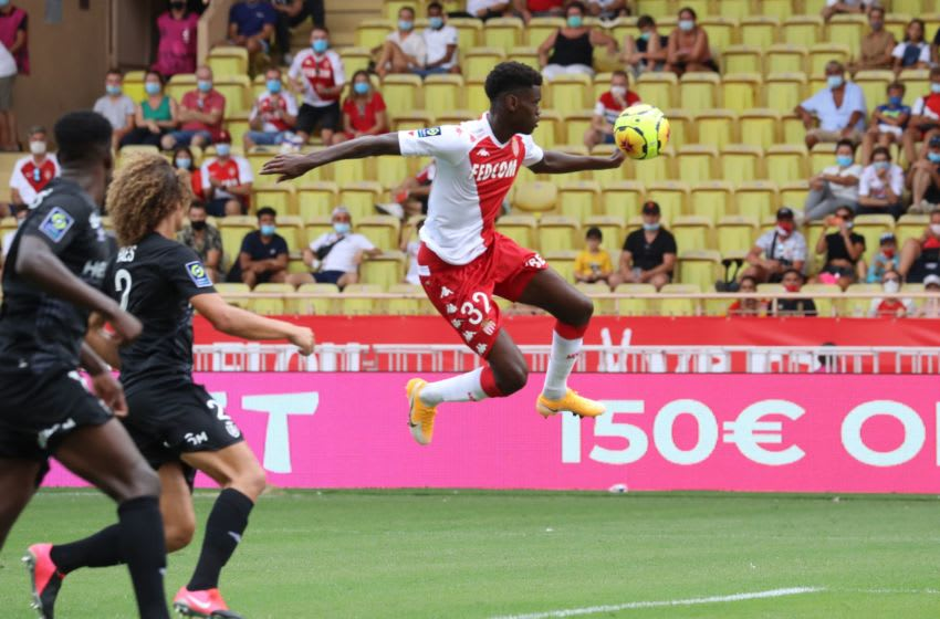 Monaco's French defender Benoit Badiashile controls the ball as he prepares to score a goal during the French L1 football match between AS Monaco and Stade de Reims at The