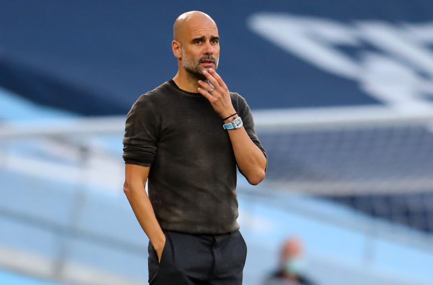 Manchester City's Spanish manager Pep Guardiola gestures on the touchline during the English Premier League football match between Manchester City and Leicester City at the Etihad Stadium in Manchester, north west England, on September 27, 2020. (Photo by Catherine Ivill / POOL / AFP) / RESTRICTED TO EDITORIAL USE. No use with unauthorized audio, video, data, fixture lists, club/league logos or 'live' services. Online in-match use limited to 120 images. An additional 40 images may be used in extra time. No video emulation. Social media in-match use limited to 120 images. An additional 40 images may be used in extra time. No use in betting publications, games or single club/league/player publications. / (Photo by CATHERINE IVILL/POOL/AFP via Getty Images)