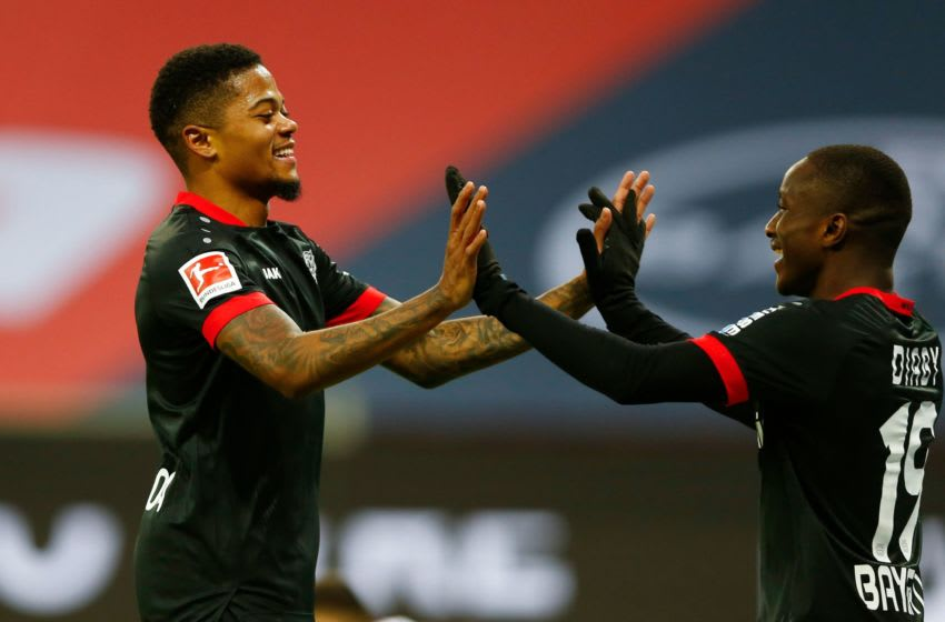 Leverkusen's Jamaican midfielder Leon Bailey (L) celebrates scoring the 3-1 goal win.