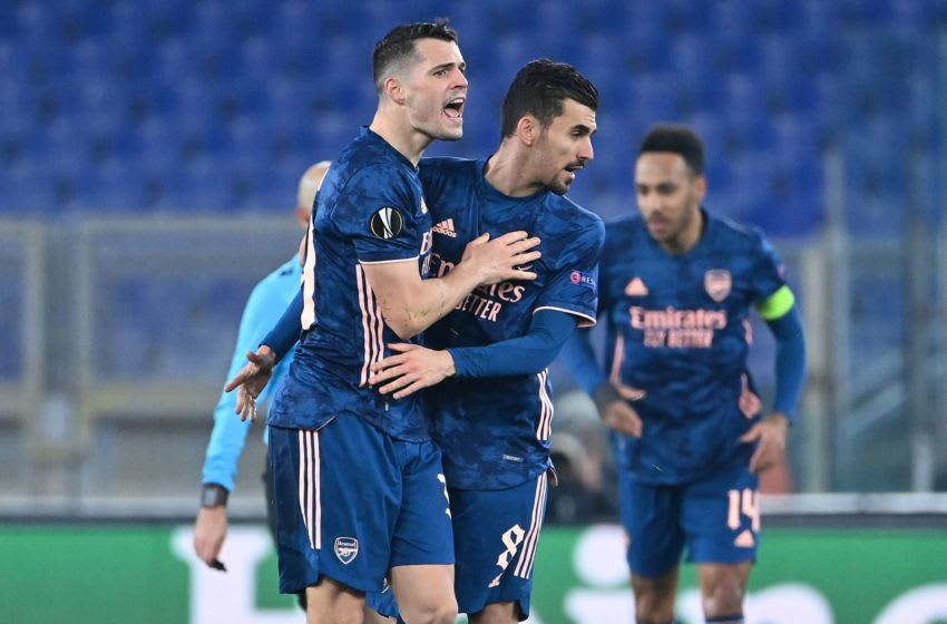 Arsenal's Swiss midfielder Granit Xhaka (L) celebrates with Arsenal's Spanish midfielder Dani Ceballos after their team scored a goal during the UEFA Europa League round of 32 first leg football match between SL Benfica and Arsenal at the Olimpico stadium in Rome on February 18, 2021. (Photo by Alberto PIZZOLI / AFP) (Photo by ALBERTO PIZZOLI/AFP via Getty Images)
