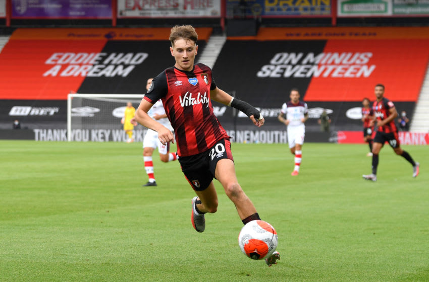 BOURNEMOUTH, ENGLAND - JULY 19: David Brooks of AFC Bournemouth runs with the ball during the Premier League match between AFC Bournemouth and Southampton FC at Vitality Stadium on July 19, 2020 in Bournemouth, England. Football Stadiums around Europe remain empty due to the Coronavirus Pandemic as Government social distancing laws prohibit fans inside venues resulting in all fixtures being played behind closed doors. (Photo by Mike Hewitt/Getty Images)