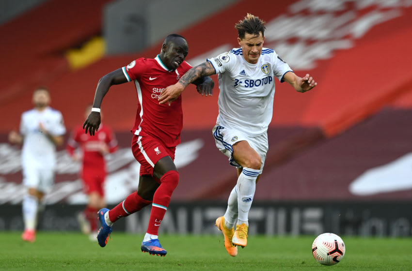 LIVERPOOL, ENGLAND - SEPTEMBER 12: Robin Koch of Leeds United is challenged by Sadio Mane of Liverpool during the Premier League match between Liverpool and Leeds United at Anfield on September 12, 2020 in Liverpool, England. (Photo by Shaun Botterill/Getty Images)