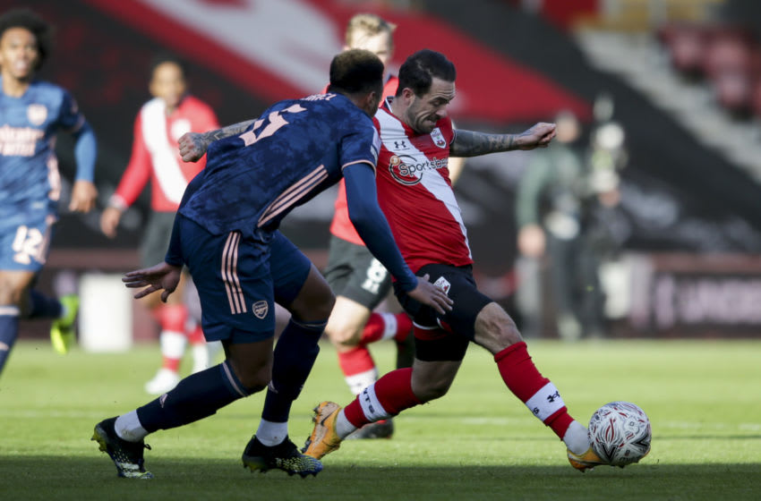 SOUTHAMPTON, ENGLAND - JANUARY 23: Gabriel of Arsenal closes down Danny Ings of Southampton during Southampton v Arsenal, The Emirates FA Cup Fourth Round, on January 23, 2021 in Southampton, England. Sporting stadiums around the UK remain under strict restrictions due to the Coronavirus Pandemic as Government social distancing laws prohibit fans inside venues resulting in games being played behind closed doors. (Photo by Robin Jones/Getty Images)
