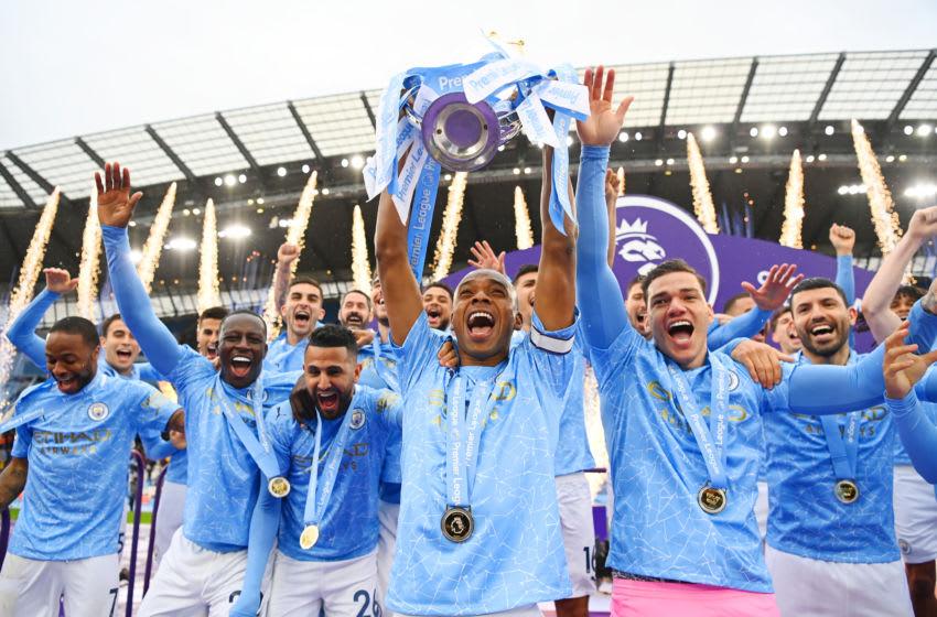 Fernandinho lifts the Premier League Trophy after Man City won the title. (Photo by Michael Regan/Getty Images)