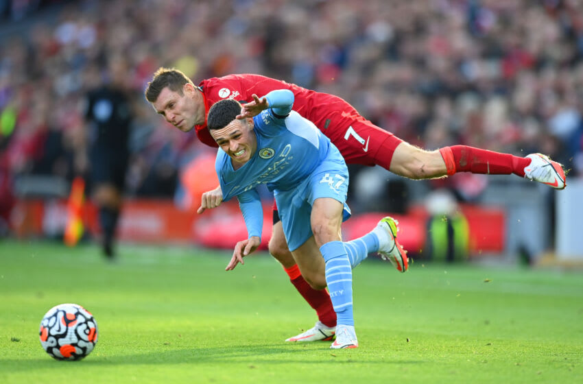 Liverpool's James Milner earned a yellow card for this foul on Manchester City's Phil Foden. (Photo by Michael Regan/Getty Images)