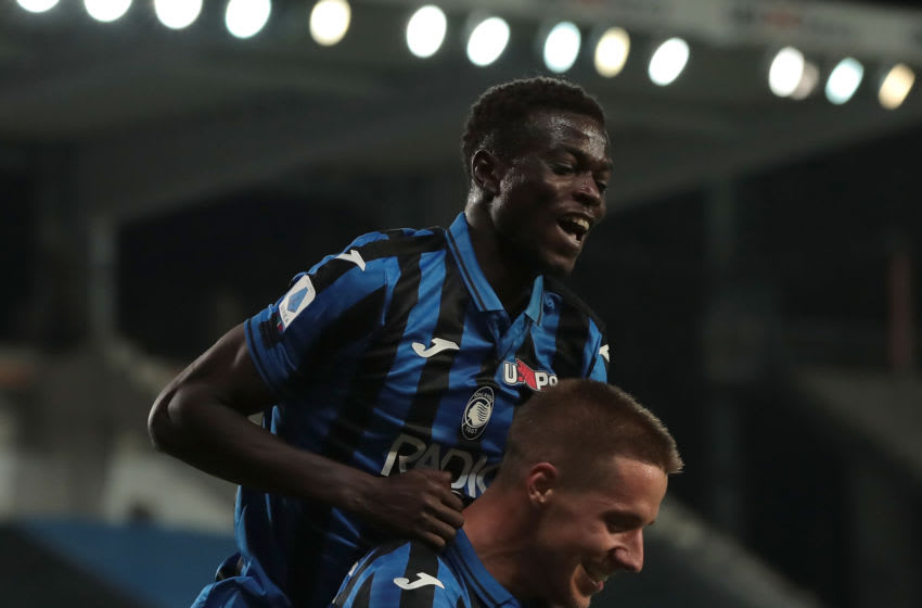 BERGAMO, ITALY - JULY 14: Mario Pasalic of Atalanta BC celebrates his third goal with his teammate Ebrima Colley during the Serie A match between Atalanta BC and Brescia Calcio at Gewiss Stadium on July 14, 2020 in Bergamo, Italy. (Photo by Emilio Andreoli/Getty Images)