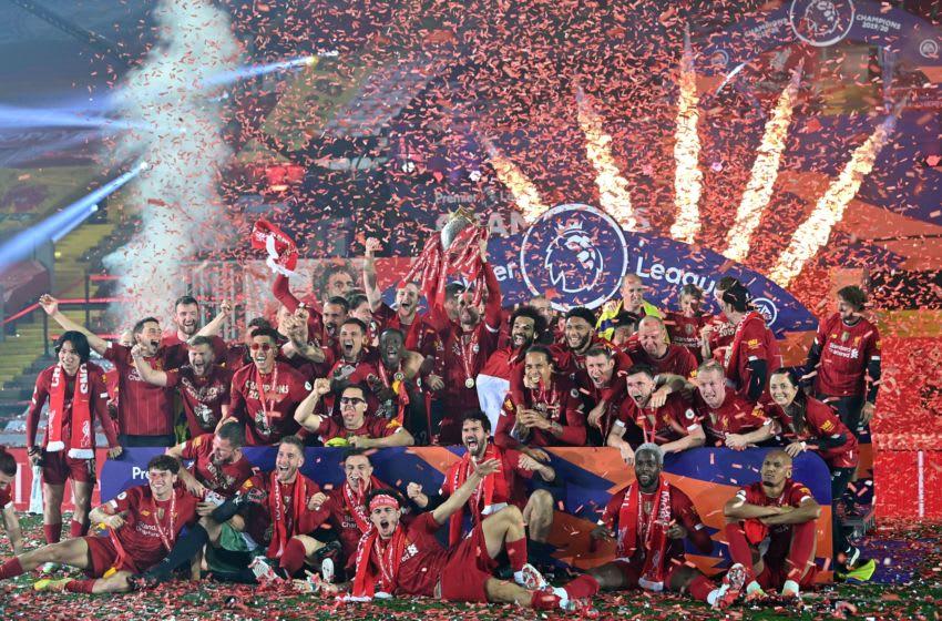 Liverpool lift the Premier League trophy for 2019/20 season (Photo by PAUL ELLIS/POOL/AFP via Getty Images)