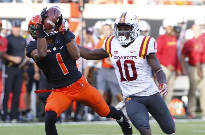 Oct 8, 2016; Stillwater, OK, USA; Oklahoma State Cowboys wide receiver Jalen McCleskey (1) makes a catch ahead of Iowa State Cyclones defensive back Brian Peavy (10) during the second half at Boone Pickens Stadium. Oklahoma State won 38-31. Mandatory Credit: Alonzo Adams-USA TODAY Sports