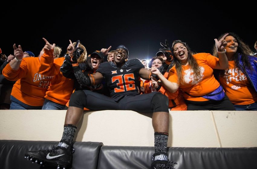 Nov 12, 2016; Stillwater, OK, USA; Oklahoma State Cowboys safety Derrick Moncrief (36) celebrates with fans after the game against the Texas Tech Red Raiders at Boone Pickens Stadium. Cowboys won 45-44. Mandatory Credit: Rob Ferguson-USA TODAY Sports