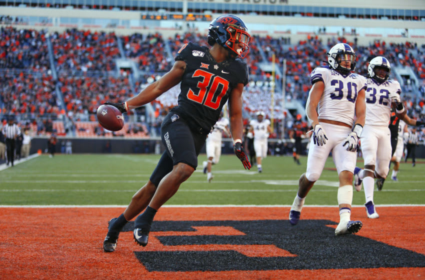 STILLWATER, OK - NOVEMBER 2: Running back Chuba Hubbard #30 of the Oklahoma State Cowboys scores on a 62-yard run against linebacker Garret Wallow #30 and defensive end Ochaun Mathis #32 of the TCU Horned Frogs on November 2, 2019 at Boone Pickens Stadium in Stillwater, Oklahoma. OSU won 34-27. (Photo by Brian Bahr/Getty Images)