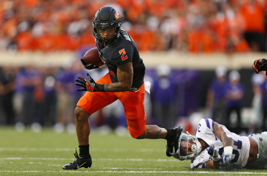 STILLWATER, OK - SEPTEMBER 28: Wide receiver Tylan Wallace #2 of the Oklahoma State Cowboys picks up 25 yards on a catch as he escapes the reach of defensive back Jahron McPherson #31 of the Kansas State Wildcats in the second quarter on September 28, 2019 at Boone Pickens Stadium in Stillwater, Oklahoma. OSU won 26-13. (Photo by Brian Bahr/Getty Images)