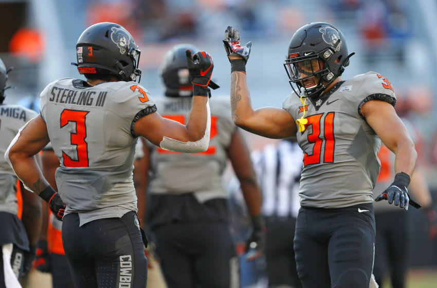 STILLWATER, OK - OCTOBER 24: Safeties Tre Sterling #3 and Kolby Harvell-Peel #31 of the Oklahoma State Cowboys celebrate the 24-21 win against the Iowa State Cylcones at Boone Pickens Stadium on October 24, 2020 in Stillwater, Oklahoma. (Photo by Brian Bahr/Getty Images)