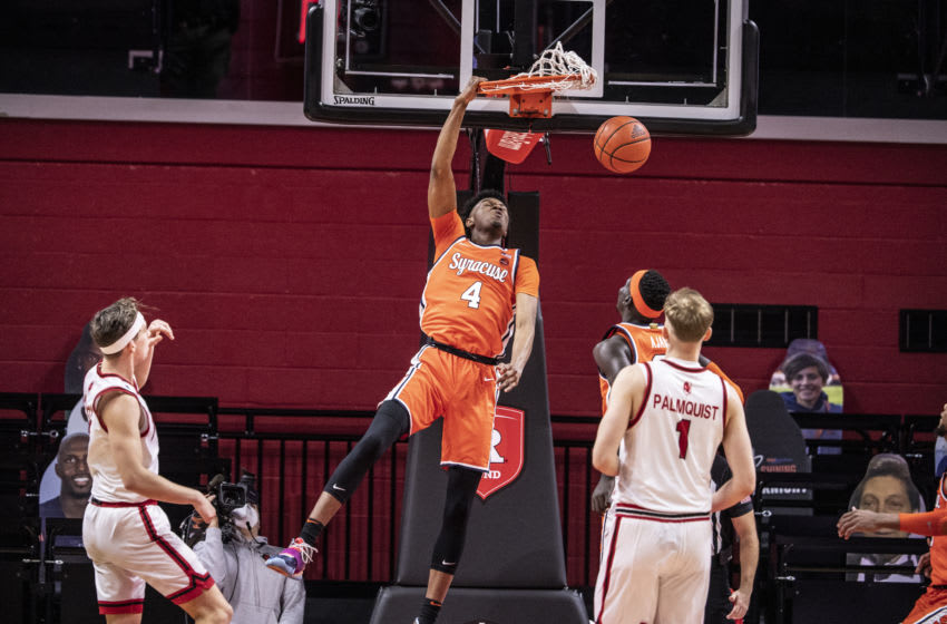 PISCATAWAY, NJ - DECEMBER 08: Woody Newton #4 of the Syracuse Orange dunks during a game against the Rutgers Scarlet Knights at the Rutgers Athletic Center on December 8, 2020 in Piscataway, New Jersey. (Photo by Benjamin Solomon/Getty Images)