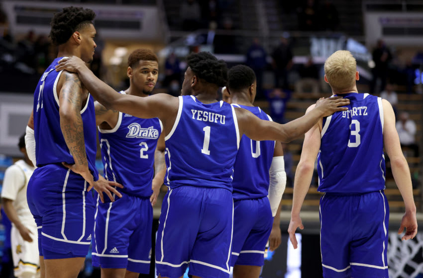 WEST LAFAYETTE, INDIANA - MARCH 18: Joseph Yesufu #1 of the Drake Bulldogs celebrates with teammates against the Wichita State Shockers during the second half in the First Four game prior to the NCAA Men's Basketball Tournament at Mackey Arena on March 18, 2021 in West Lafayette, Indiana. (Photo by Gregory Shamus/Getty Images)