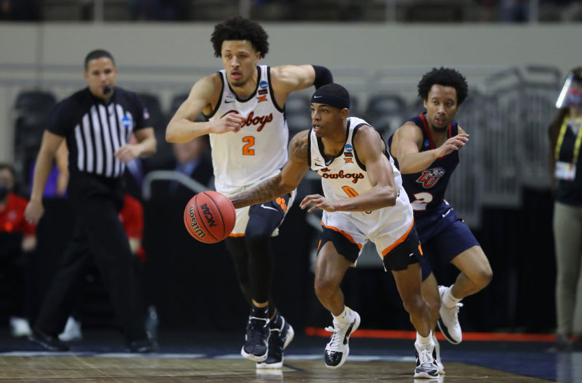 INDIANAPOLIS, INDIANA - MARCH 19: Avery Anderson III #0 of the Oklahoma State Cowboys drives down the court against the Liberty Flames during the second half in the first round game of the 2021 NCAA Men's Basketball Tournament at Indiana Farmers Coliseum on March 19, 2021 in Indianapolis, Indiana. (Photo by Maddie Meyer/Getty Images)