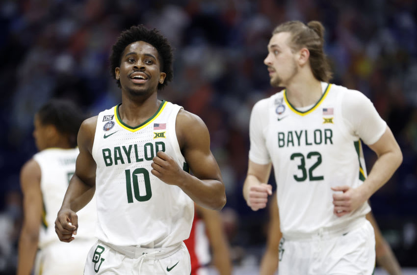 INDIANAPOLIS, INDIANA - APRIL 03: Adam Flagler #10 of the Baylor Bears reacts in the second half against the Houston Cougars during the 2021 NCAA Final Four semifinal at Lucas Oil Stadium on April 03, 2021 in Indianapolis, Indiana. (Photo by Jamie Squire/Getty Images)