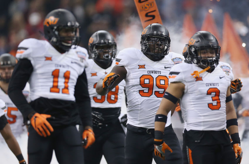 NEW ORLEANS, LA - JANUARY 01: The Oklahoma State Cowboys enter the field before playing against the Mississippi Rebels during the Allstate Sugar Bowl at Mercedes-Benz Superdome on January 1, 2016 in New Orleans, Louisiana. (Photo by Chris Graythen/Getty Images)