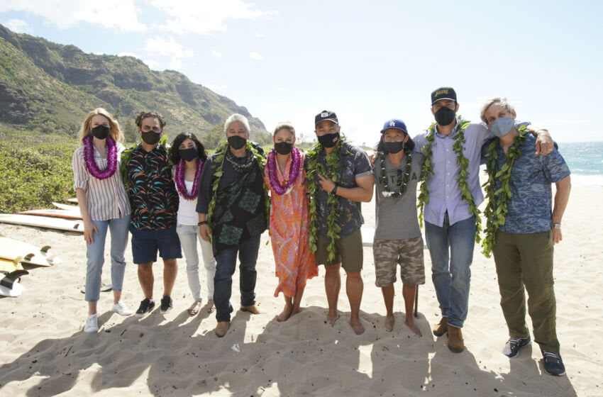 NCIS: HAWAIʹI kicked off its first season production at Mokulē'ia Beach on Oahu with a traditional Hawaiian blessing in honor of its host Hawaiian culture, which was held in line with the series' overall filming safety protocols. Series stars Vanessa Lachey, Noah Mills, Jason Antoon, Yasmine Al-Bustami and Tori Anderson, as well as the producers and the NCIS: HAWAIʹI crew, participated. Kahu (Officiant) Kordell Kekoa officiated the ceremony, which included traditional royal maile leis, Oli Aloha (welcoming chant), and Pule Ho'oku'u (closing prayer). In honor of the show's premiere season, the ceremony centered on the constant motion of the ocean and how the moving ocean waters, driven by the winds and tides, connects the entire planet. Pictured L-R: Tori Anderson, Jason Antoon, Yasmine Al-Bustami, Kahu (Officiant) Ramsey Taum presides over the blessing ceremony, Vanessa Lachey, Executive Producer / Director Larry Teng, and Director of Photography Yasu Tanida, Noah Mills, and Co-Executive Producer Tim Andrew Photo: Karen Neal/CBS ©2021 CBS Broadcasting, Inc. All Rights Reserved.