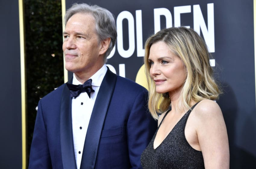 BEVERLY HILLS, CALIFORNIA - JANUARY 05: David E. Kelley (L) and Michelle Pfeiffer attends the 77th Annual Golden Globe Awards at The Beverly Hilton Hotel on January 05, 2020 in Beverly Hills, California. (Photo by Frazer Harrison/Getty Images)