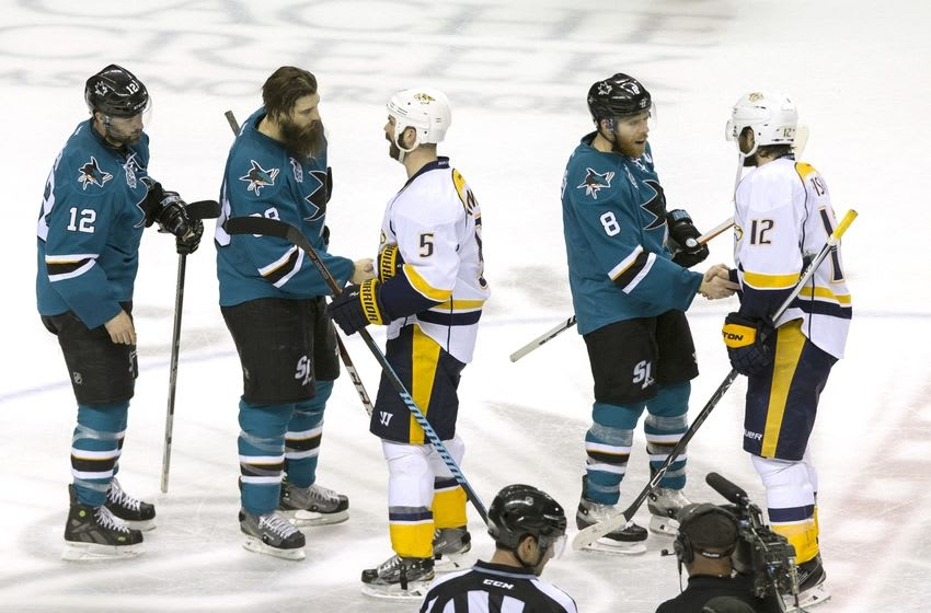May 12, 2016; San Jose, CA, USA; San Jose Sharks center Joe Pavelski (8) and defenseman Brent Burns (88) and center Patrick Marleau (12) shake hands with Nashville Predators center Mike Fisher (12) and defenseman Barret Jackman (5) after the end of the game seven of the second round of the 2016 Stanley Cup Playoffs at SAP Center at San Jose. San Jose defeated Nashville 5-0. Mandatory Credit: Neville E. Guard-USA TODAY Sports