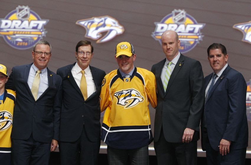 Jun 24, 2016; Buffalo, NY, USA; Dante Fabbro poses for a photo after being selected as the number seventeen overall draft pick by the Nashville Predators in the first round of the 2016 NHL Draft at the First Niagra Center. Mandatory Credit: Timothy T. Ludwig-USA TODAY Sports